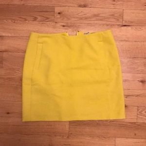 Bright yellow front pocket skirt